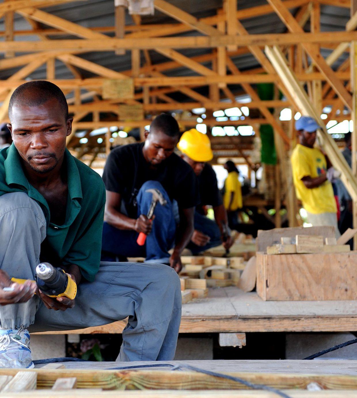 Preparing shelter materials workers prepare materials for transi